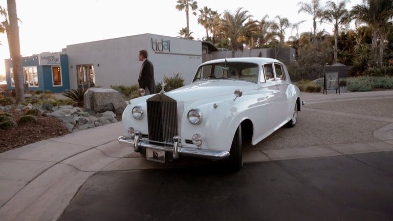 The old-fashioned white car to take them to dinner.