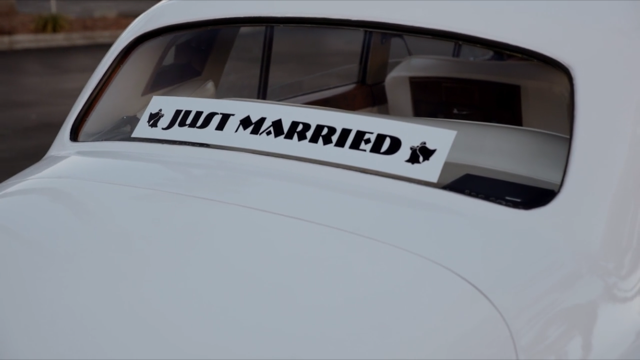 """""""Just married"""" sticker on the back windshield."""
