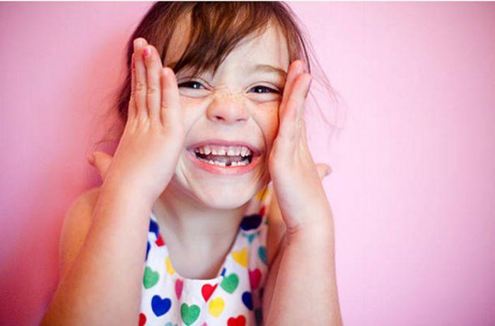 удалить молочный зуб