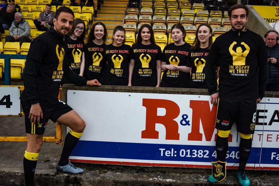 Livingston FC Play-off T-shirts - A massive thank you to our local team Livingston Football Club for helping us to raise funds! Approached by a Livingston fan we didn't think making a t-shirt in support of the manager would have taken off on such a huge scale - all the players warmed up in them on their home leg of the first round of the play-offs and then signed them and gave us them back to auction off.