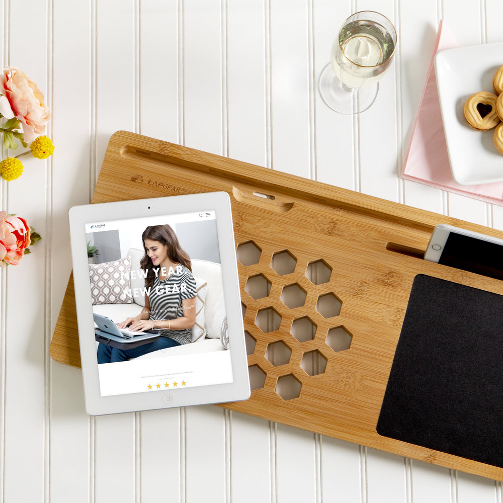 "BAMBOARD   $29.99   FITS LAPTOPS UP TO 15"":  22"" x 11""   MEDIA SLOTS : Fits tablets up to 13"" and cell phones up to 7.9""   STYLE : Made from natural bamboo (a renewable resource)   IMPROVED AIR-FLOW : 29 ventilation holes allow for proper laptop ventilation, as recommended by laptop manufacturers."