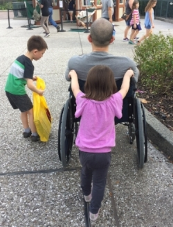 The silver lining of our vacation injury adventure?  New skills and opportunities to be of service!  Here is our 4-year-old working on pushing Daddy in the wheelchair, while our 7-year-old works on carrying a heavy bag :)