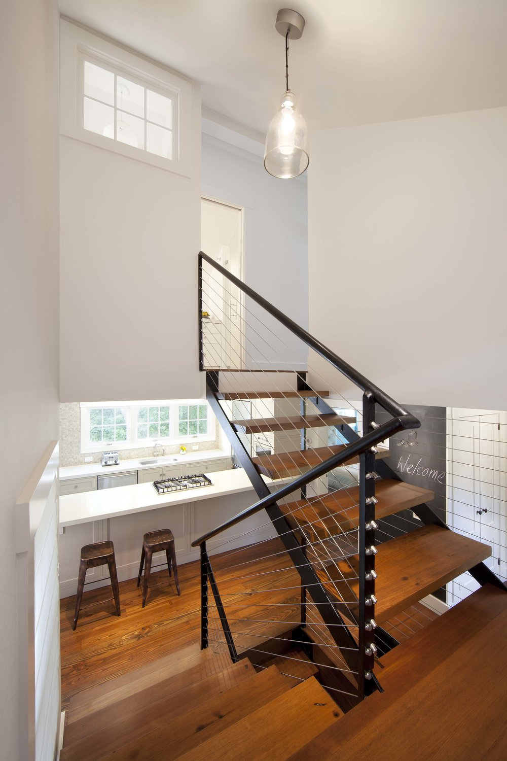 Custom steel staircase with floating wood treads.