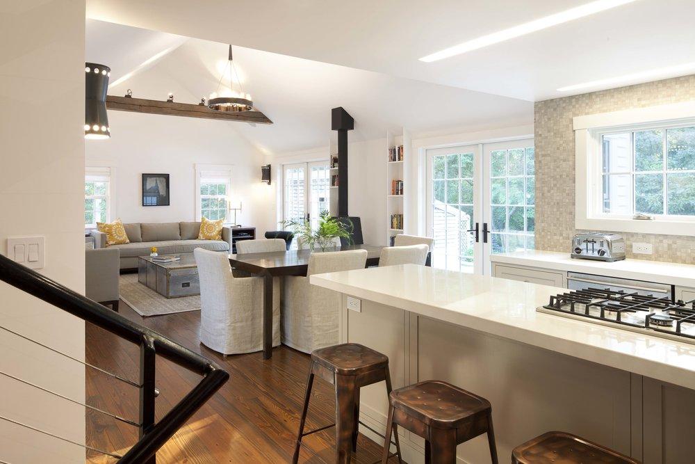 Open european style kitchen with concrete countertops.