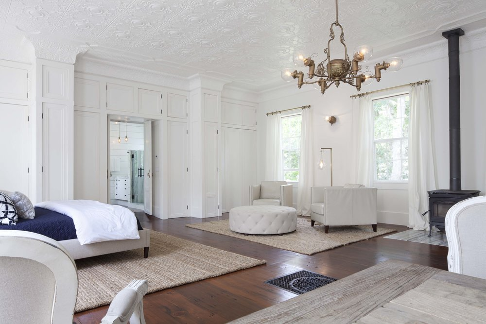 Master suite with tin ceiling and antique chandelier.
