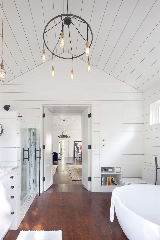 Martha's Vineyard master bathroom ship-lap with modern chandelier.