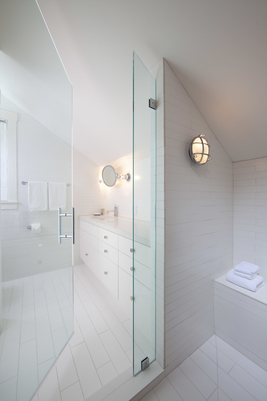 Ann Sacks tile white bathroom with nautical lights.