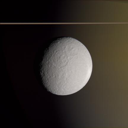 Color view of Rhea Against Saturn