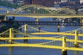 These Pittsburgh bridges, painted in Aztec Gold, are among the 446 in the city. Portland is hardly competitive with its 12 spans across the Willamette.