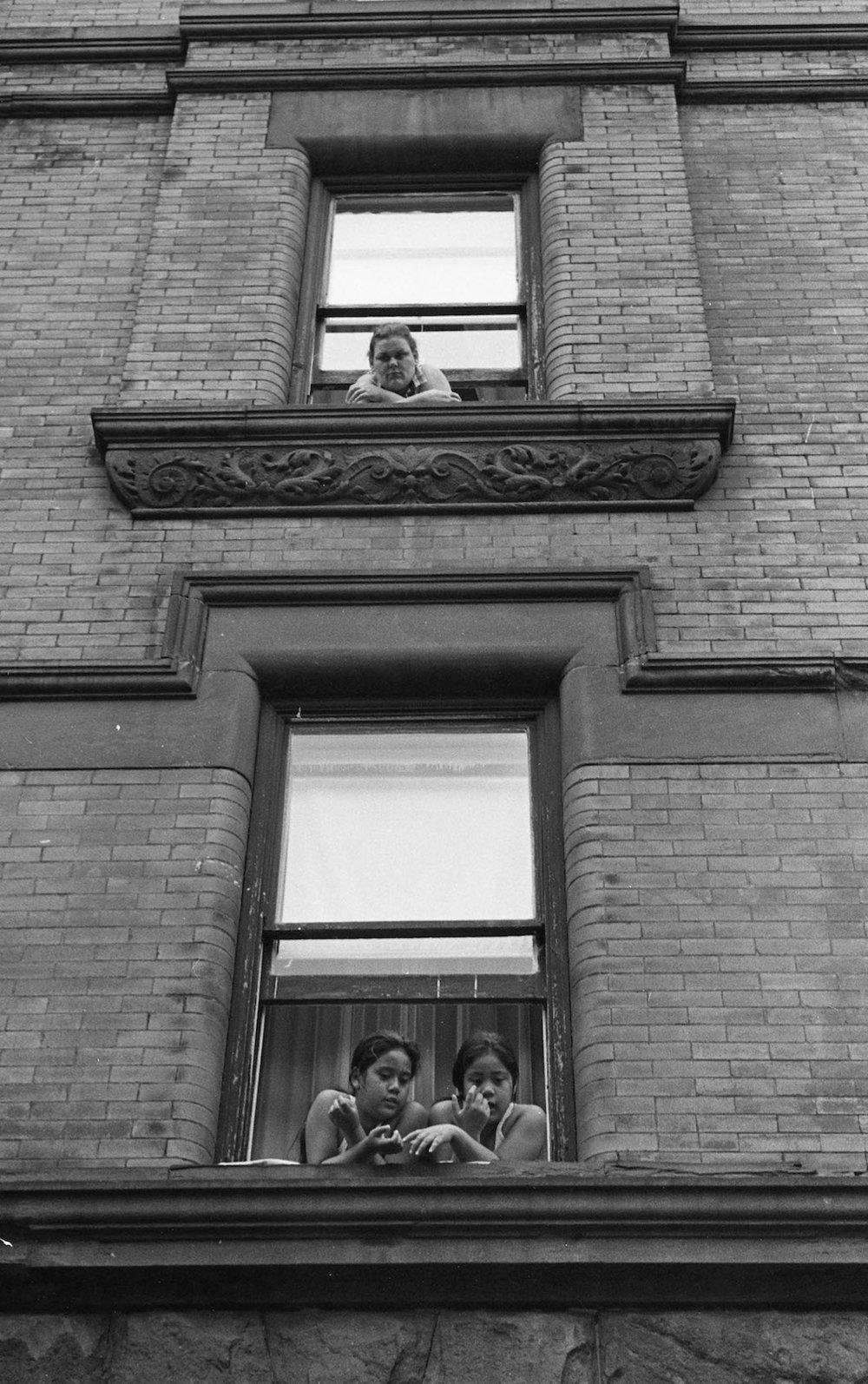 Three People in Window