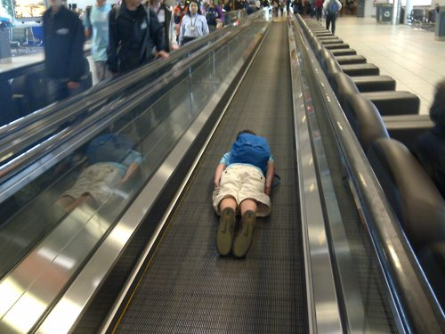 Full disclosure: That's not really me lying on the moving walkway... I did eat Cinnabon, though.