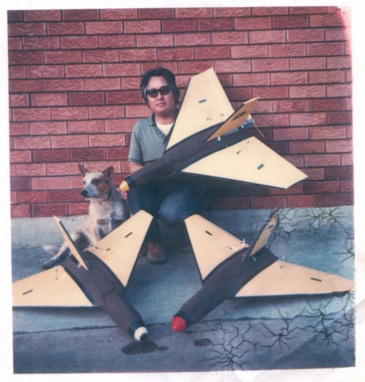 Barry Ming, master craftsman with his faithful companion Blue Dog and three Silvertone® MAT-DF aircraft ready for firing trials. This was an immensely successful target and the gunners loved them for the modern realistic profile they presented in flight.