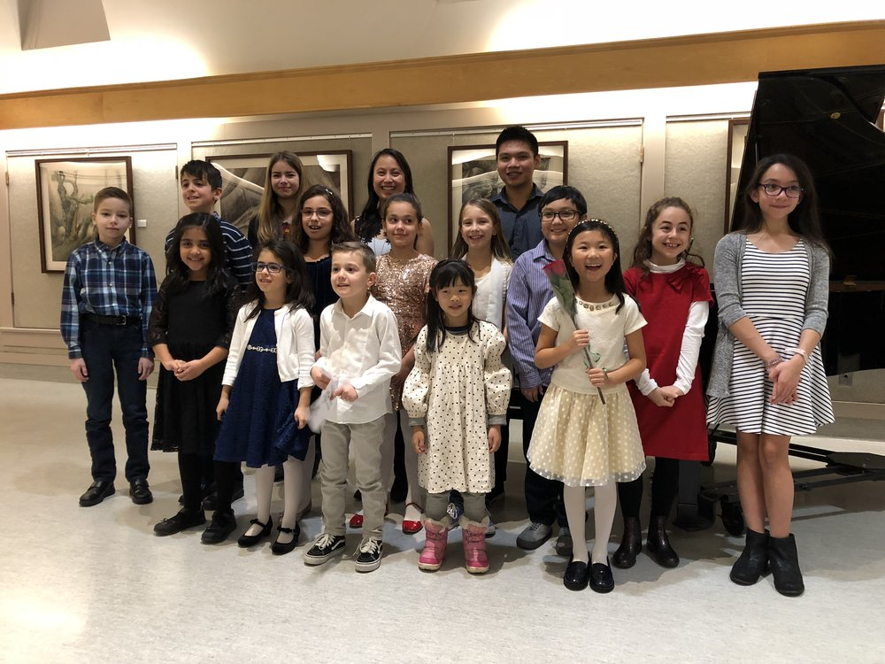 Smiling faces after a successful christmas recital at Place des Arts 2018.