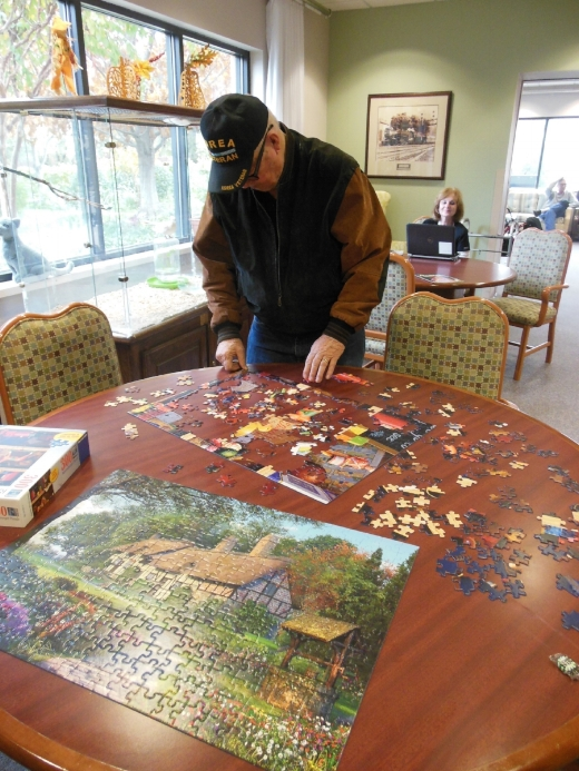 Senior Adult Day Program - Activity spaces from within the program with a view of the beautiful outside walking gardens.