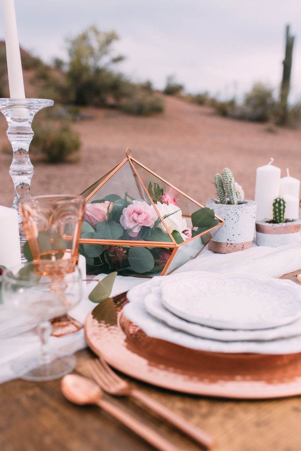 copper and white wedding place setting with potted cactus