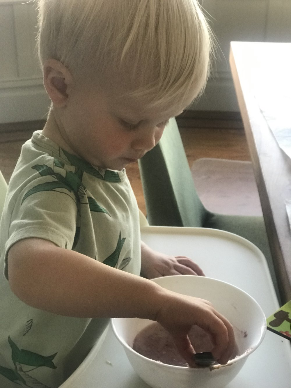 Linc enjoying one of his many pink oatmeal breakfasts with almond milk and peanut butter as preferred topping