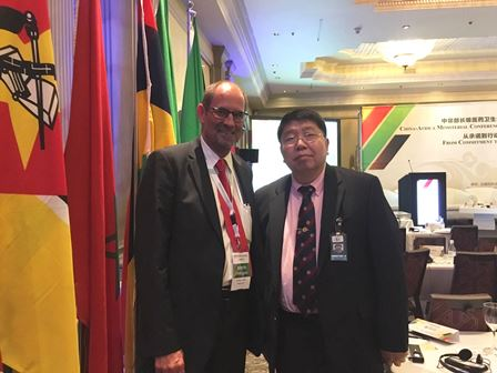 Professor Ma with Dr. Chris Benn, Director of External Relations of The Global Fund in the Conference