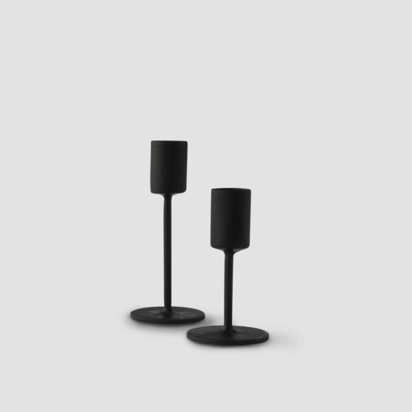 NOIR CANDLESTICK HOLDER | BLACK  Black iron. Available in tall and short and comes in pairs Size : (L) H 25 cm (S) H 10 cm  IDR 10,000/per pair  Qty Available: 57 set