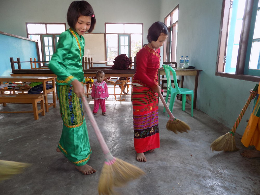 After prayers she cleans the school with her friends.