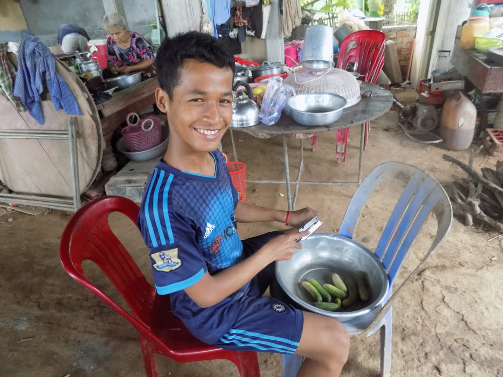 In the evening, Narak helps cook dinner for his family.