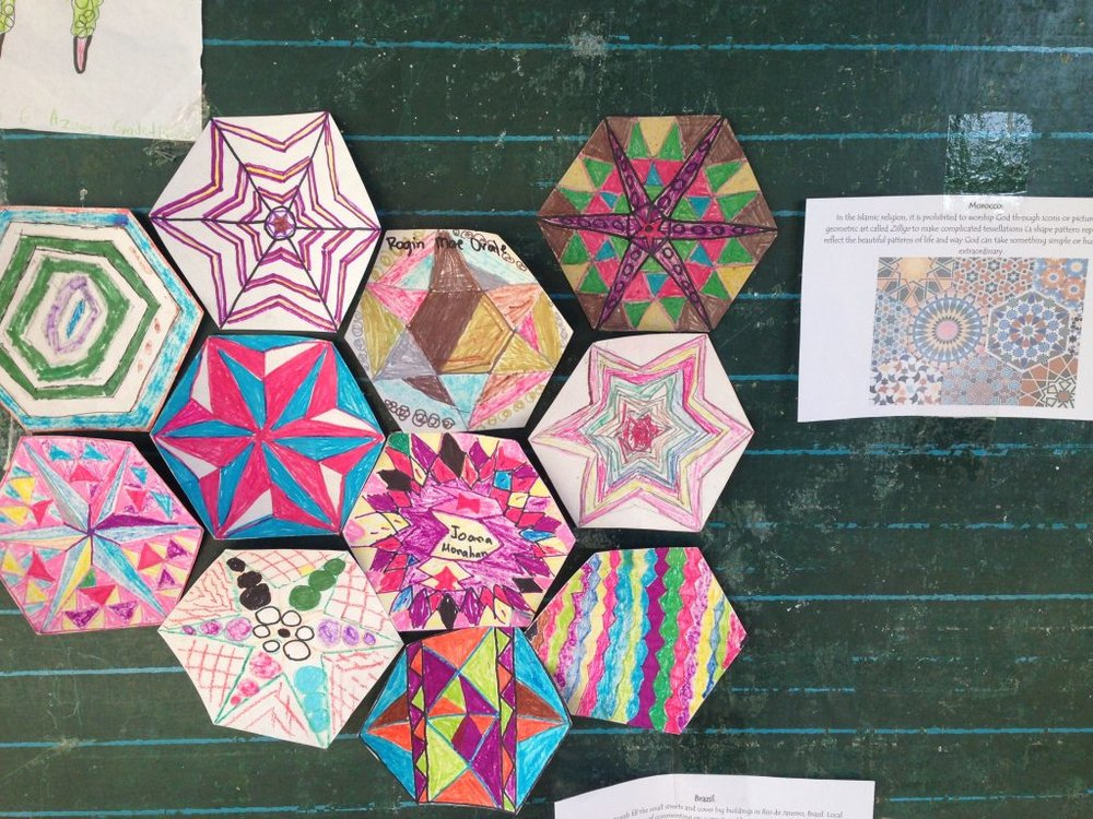 After studying tessellation in Islamic art, the divine geometry called Zellige, the 4-6 grade class made their own inspired tiles.