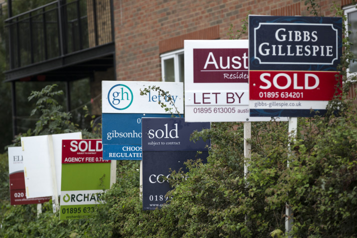 A row of estate agent boards in London   Oli Scarff/Getty