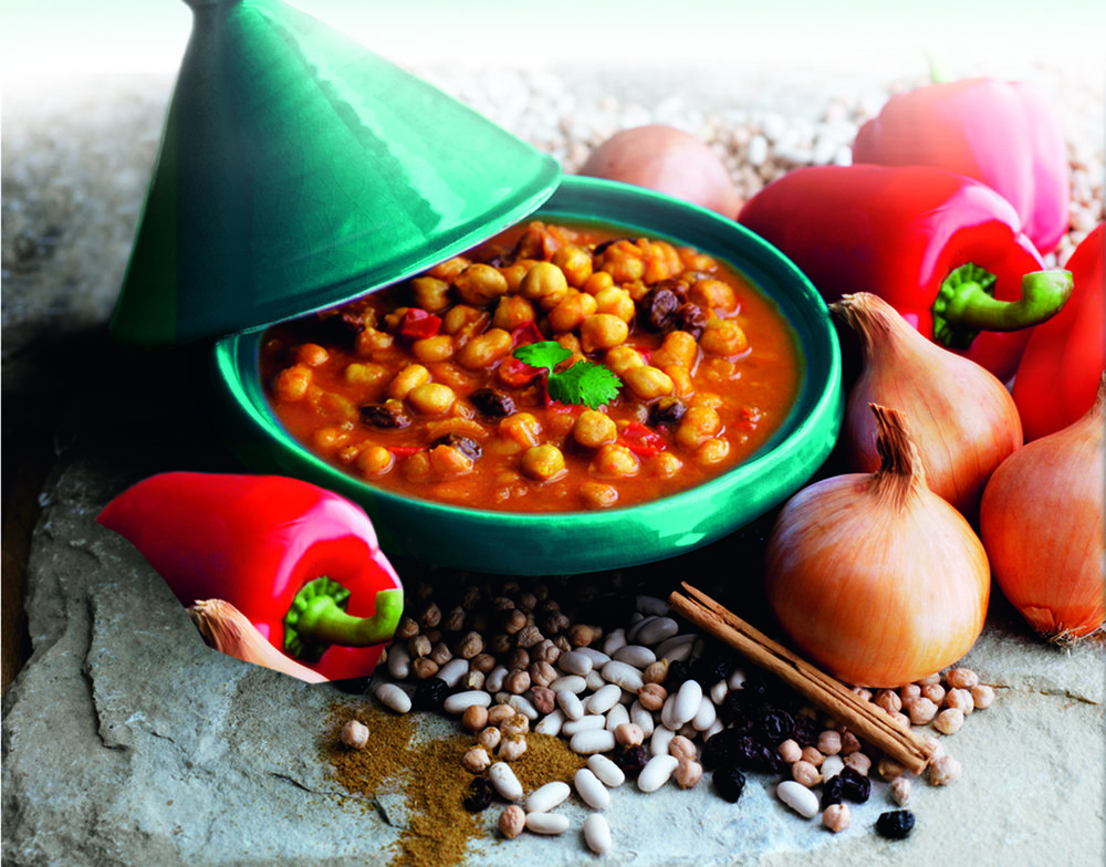 Chickpea and Bean Tagine - A rich Moroccan style stew cooked with onions, red peppers, raisins and traditional spices.