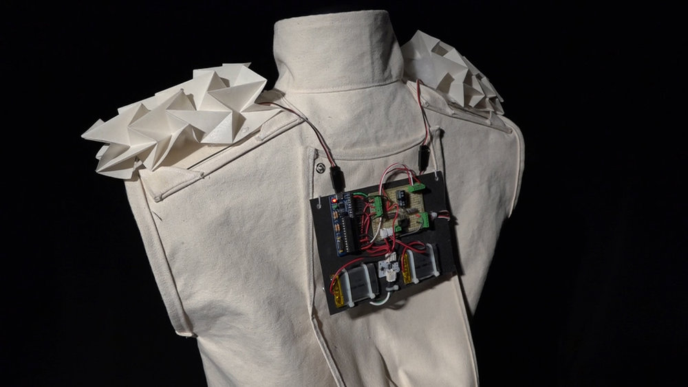 - By exposing the wearer's pulse beAT communicates the physical and emotional state of an individual. The vest challenges social boundaries by revealing an aspect of the wearer's physiology.