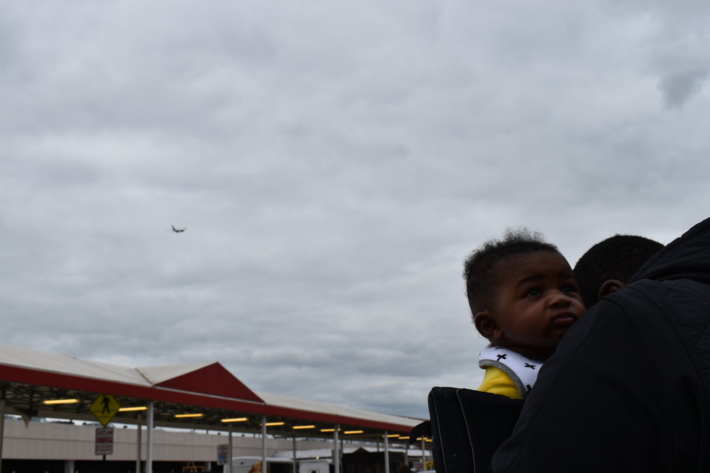 Donovan, 4 months, and father Donzell Floyd prepare to take their first flight together at Hartsfield-Jackson International Airport. LAUREN FLOYD / INFO@HONEYCOMBMOMS.COM