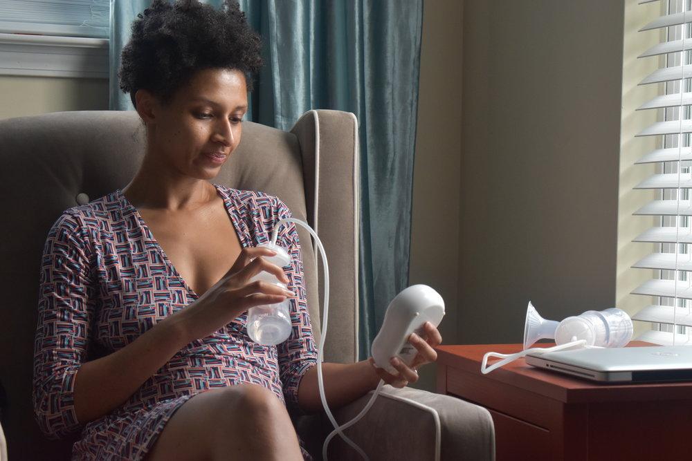 Lauren Floyd gives Aeroflow's Motif Duo breast pump a try at home in Atlanta, Ga. LAUREN FLOYD / INFO@HONEYCOMBMOMS.COM