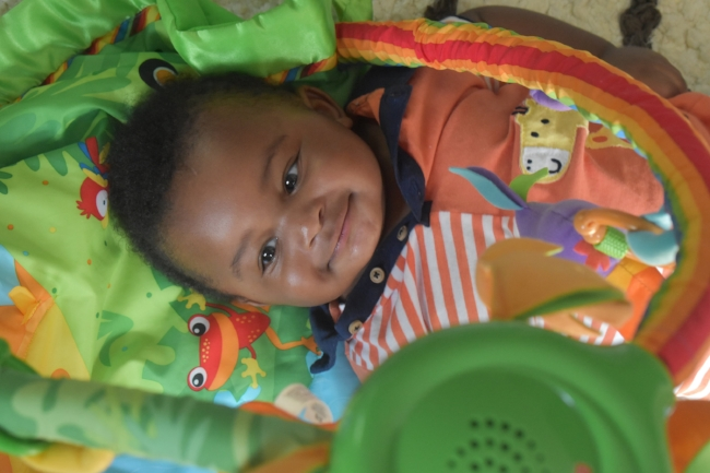 Donovan often ends up rolling to his back during tummy time. He was taking a break here to play with his activity mat at home in Atlanta, Ga. LAUREN FLOYD / INFO@HONEYCOMBMOMS.COM