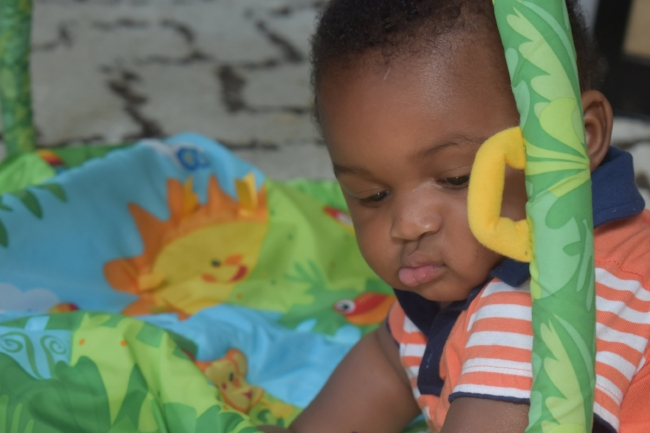 Donovan plays on his activity mat during tummy time at home in Atlanta, Ga. LAUREN FLOYD / INFO@HONEYCOMBMOMS.COM