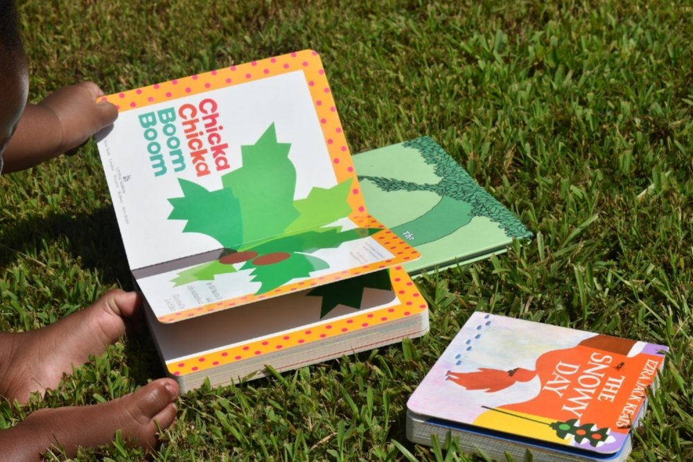 Honeycomb kid Donovan poses for photos with books in his front lawn in Atlanta, Ga. LAUREN FLOYD / INFO@HONEYCOMBMOMS.COM