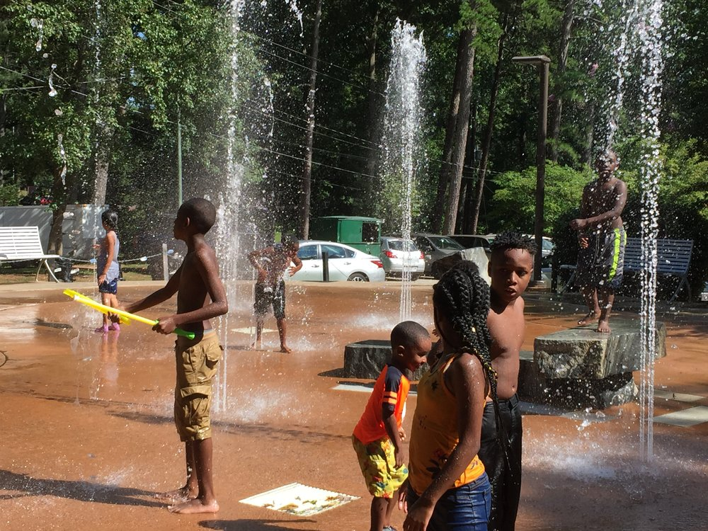 A letter to my son: What black boys need to know | Honeycomb Moms | Children played at the Perkerson Park splash pad during this year's Reggae in the Park event in Atlanta. LAUREN FLOYD / INFO@HONEYCOMBMOMS.COM