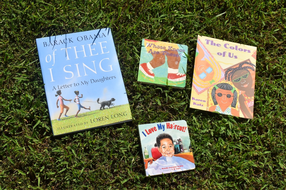READ: 14 books for your young, gifted and black child | Honeycomb Moms | These are a few books from my son Donovan's collection in front of our home in Atlanta, Ga. LAUREN FLOYD / INFO@HONEYCOMBMOMS.COM