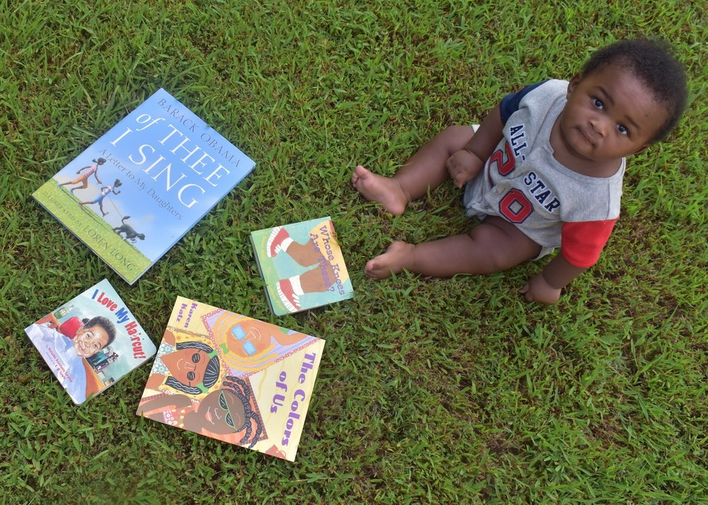 READ: 14 books for your young, gifted and black child | Honeycomb Moms | My son, Donovan, poses with a few books from his very own home collection in Atlanta, Ga. LAUREN FLOYD / INFO@HONEYCOMBMOMS.COM