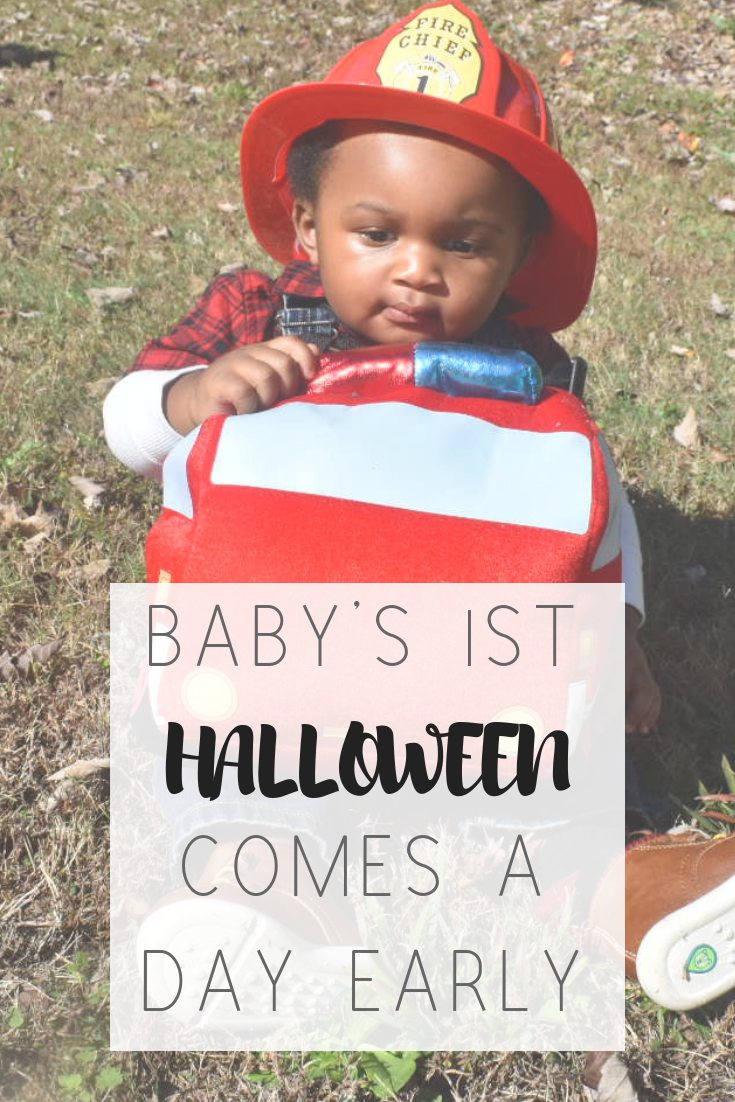 Baby's first Halloween comes a day early | Honeycomb Moms | My husband, Donzell Floyd, proudly holds our son, Donovan, at Midtown Atlanta's Scare on the Square Tuesday. LAUREN FLOYD / INFO@HONEYCOMBMOMS.COM