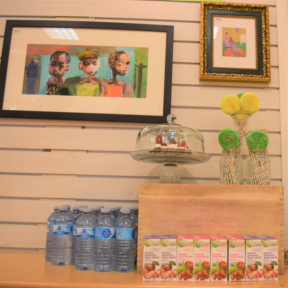 How to plan a stress-free 1st birthday without breaking the bank | Honeycomb Moms | Artwork adds a unique touch of decor at GAS-Art Gifts, the children's bookstore where I celebrated my son Donovan's first birthday with reading and art. His theme was Storybooks, Paintbrushes and Wonder. | LAUREN FLOYD / INFO@HONEYCOMBMOMS.COM