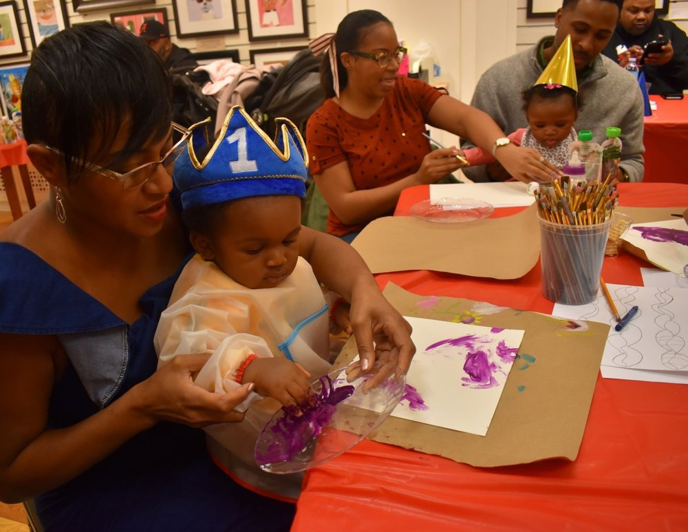 How to plan a stress-free 1st birthday without breaking the bank | Honeycomb Moms | My son Donovan celebrated his first birthday with his grandma, Michelle Breland, and other guests Saturday at GAS-Art Gifts in Perimeter Mall. | LAUREN FLOYD / INFO@HONEYCOMBMOMS.COM