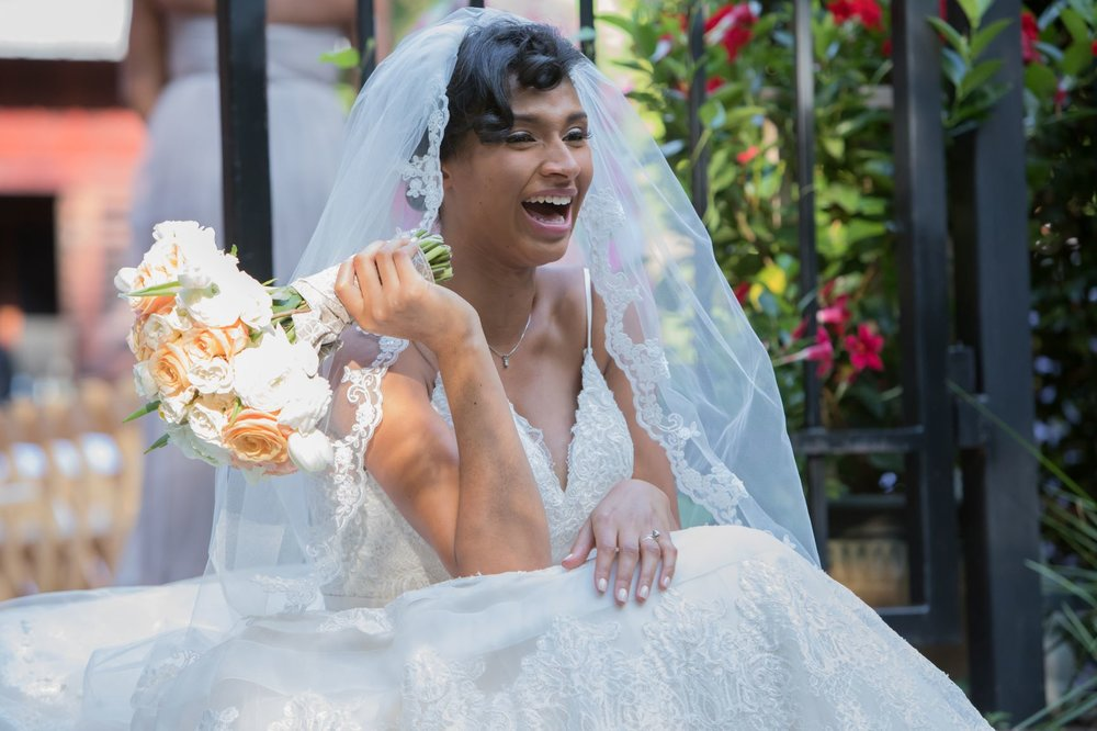 9 tips to plan your dream wedding without breaking the bank   Honeycomb Moms   I can't remember what on earth was so funny, but I was dying laughing on the steps outside my wedding venue in Atlanta.   Credit: Corey Reese