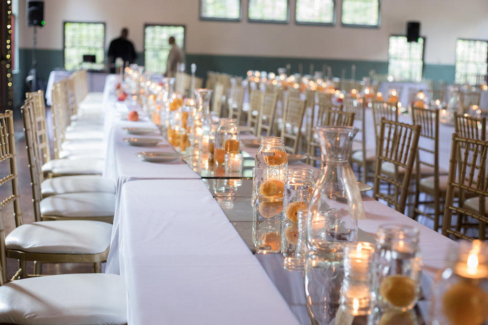 Plan an eclectic wedding reception and save big | Honeycomb Moms | We splurged on the chairs but kept costs down on the other table decor at our Atlanta wedding in early August 2017. | Credit: Corey Reese
