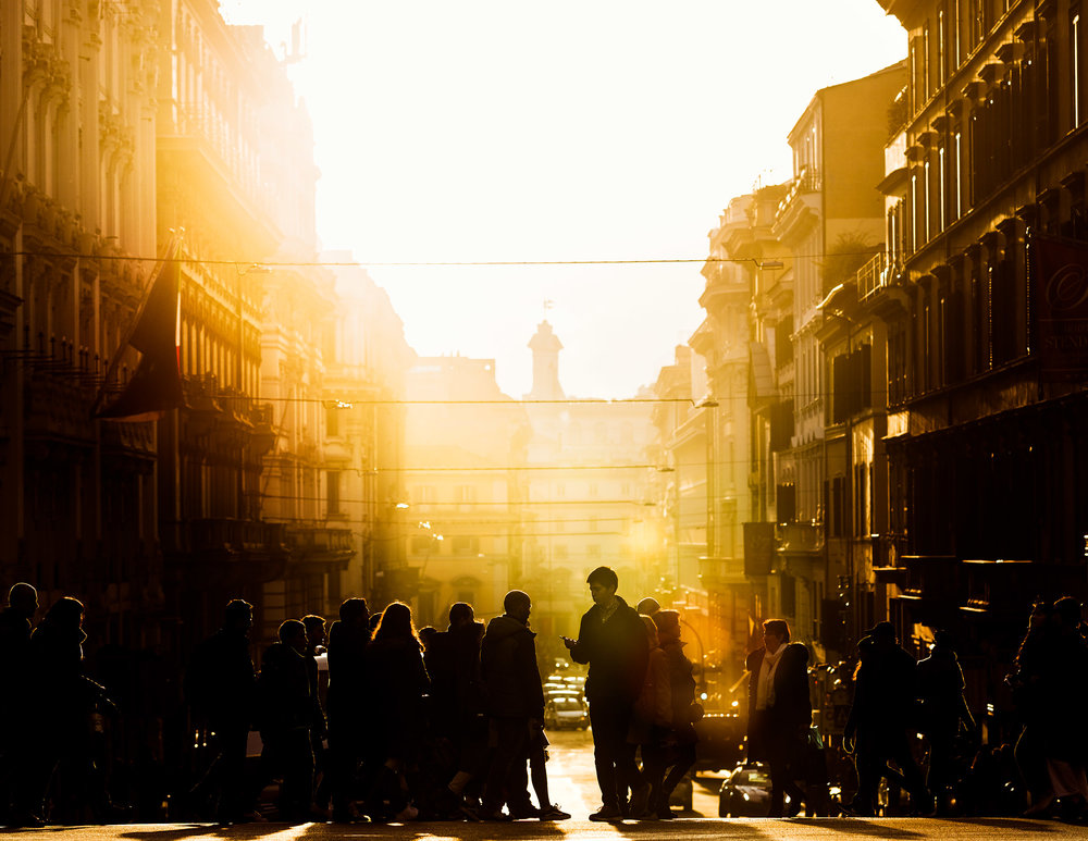People-corssing-street-in-rome-goldenhour.jpg