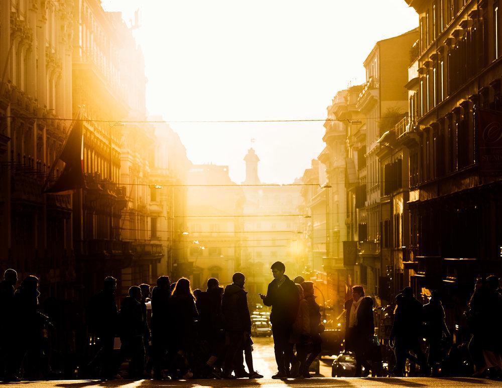 People-corssing-street-in-rome-goldenhour.jpg
