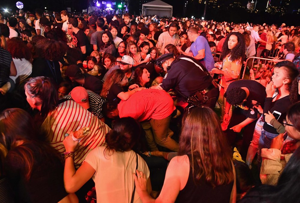 Panic spread through the crowd gathered for the Global Citizen Festival in Central Park on Sept. 29 after people scattering away from a fight stepped on empty water bottles, causing loud popping sounds.CreditCreditAngela Weiss/Agence France-Presse — Getty Images