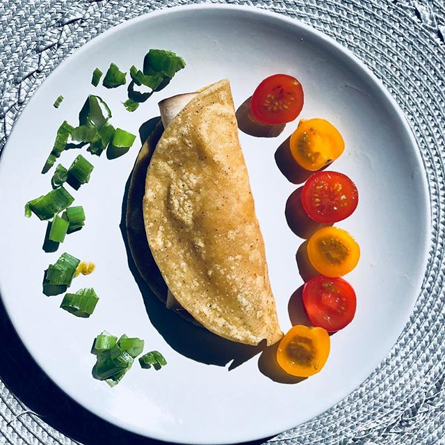 This is a typical mini meal for me any time of the day ... I'm feeling lucky to be sitting outside in the sun ☀️ on my new patio, relaxing and enjoying this delicious taco 🌮 🍃 🍅 . It simply a whole grain corn tortilla heated in a very small amount of butter on a stickless pan, filled with warm turkey meat and melted cheddar then I stuffed it with organic heirloom baby tomatoes, green onion and lettuce 👌 . Quick and easy and so delicious! @kimberleeoren I made this for my gf the other night. What did you think? 😊