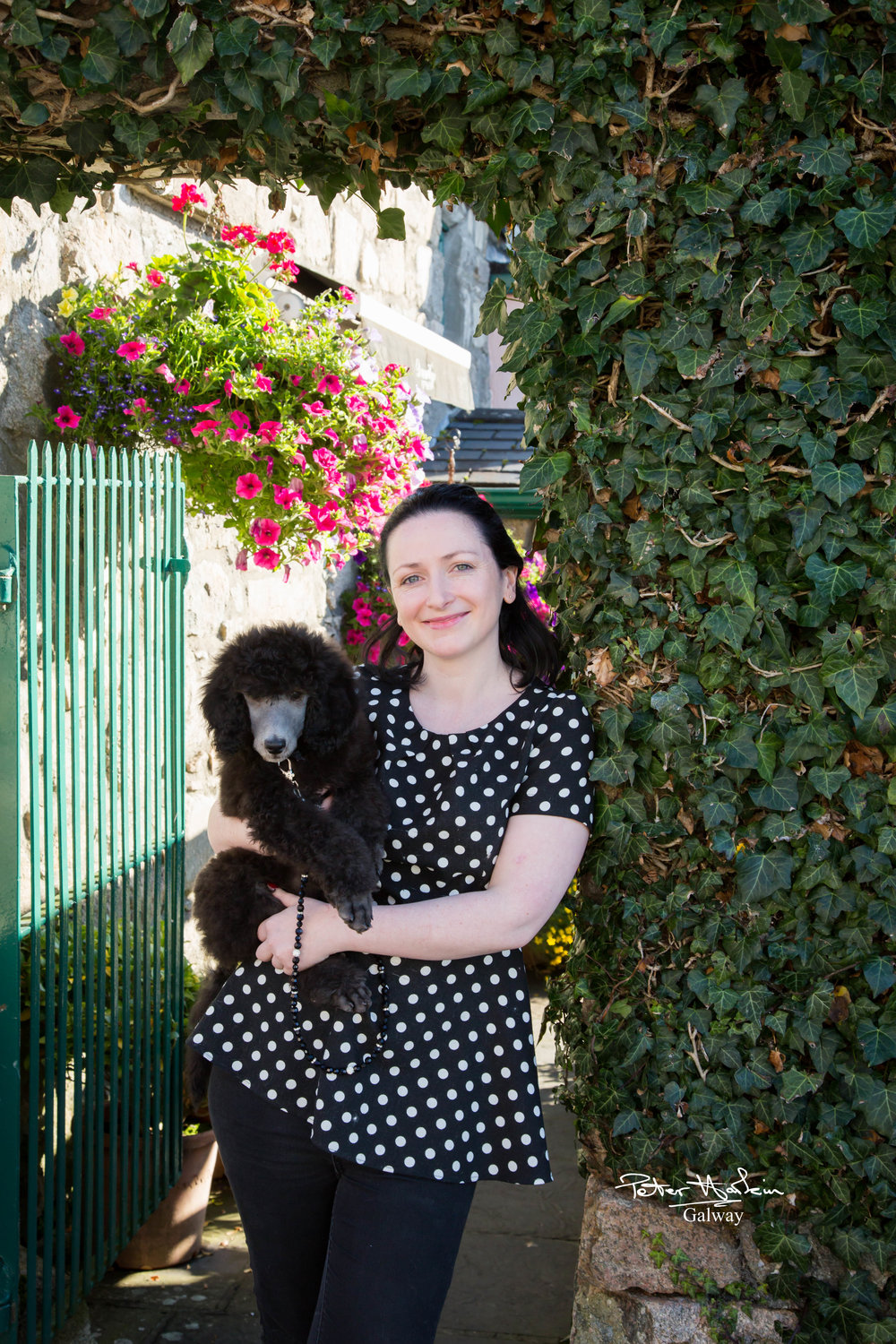 Katie and her standard poodle Gráinne aged 10 weeks