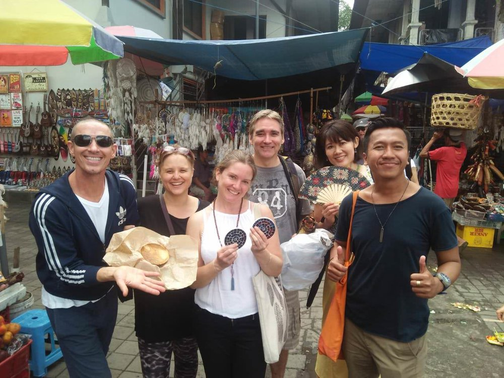 Our class & teacher with purchases from Ubud Market.