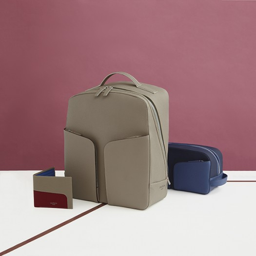 From Left to Right:   Billfold Wallet in Taupe, Red and Cobalt (FG00134742)  Backpack in Taupe (FG00136442)  Washbag in Cobalt (FG00735705)