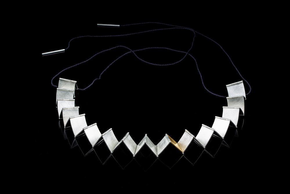 Curious Constructions | Necklace   Sterling Silver, 18ct Gold, Silk Cord | 22.5 x 22.5 x 0.2 cm