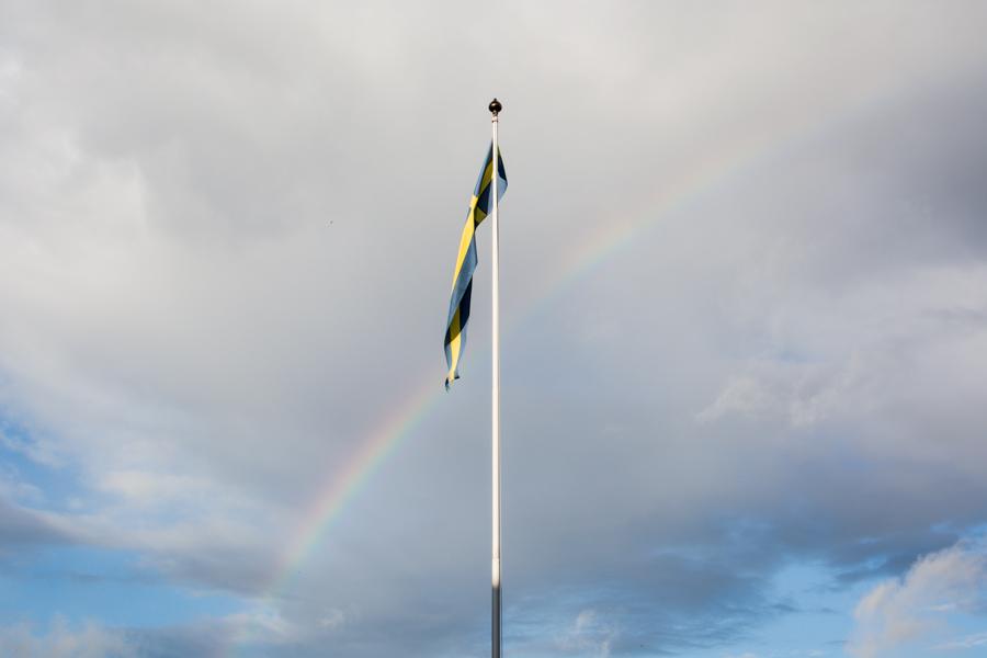 A rainbow joining the Swedish flag